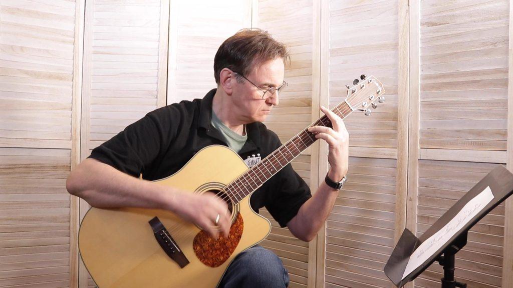 Playing a Bar Chord on Guitar