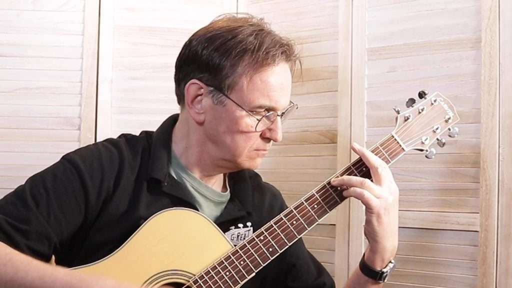 Playing a Bar Chord on Guitar