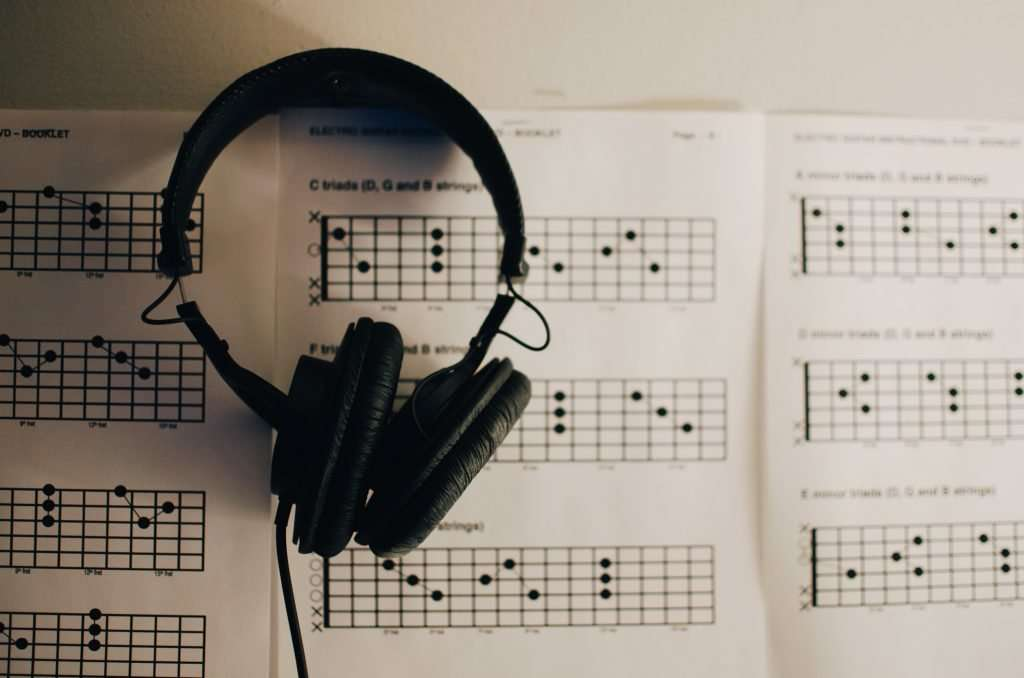 Headphones & TAB paper - useful items to use with your discount guitar courses